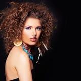 Glamorous Woman on Dark Background. Permed Hair, Makeup Royalty Free Stock Image