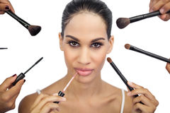 Glamorous woman encircled by make up brushes Royalty Free Stock Image