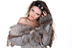 Glamorous woman in fox  fur coat with sunglasses Royalty Free Stock Photography