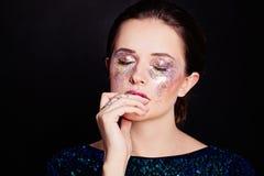 Glamorous Woman with Glitters Makeup. Beautiful Face Stock Photo