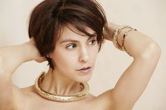 Glamorous woman in gold jewelry Royalty Free Stock Images