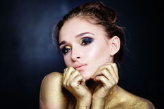 Glamorous Woman with Golden Makeup Stock Images