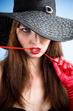 Glamorous woman in hat Stock Photography