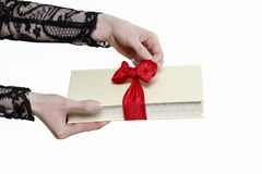 Glamorous woman holding book with big bow Royalty Free Stock Images