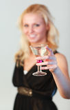 Glamorous woman holding a cocktail Stock Photos