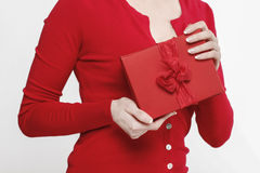 Glamorous woman holding present box Stock Images