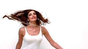 Glamorous woman jumping and spinning around stock footage