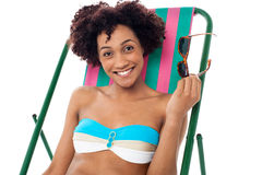 Glamorous woman in lingerie relaxing on a deckchair Stock Image