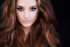 Glamorous Woman with Long Permed Hair and Smokey Eyes Stock Images