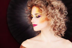 Glamorous Woman. Makeup and Blonde Curly Hair Stock Images