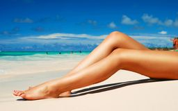 Glamorous woman with perfect legs relaxing on beac Stock Photo