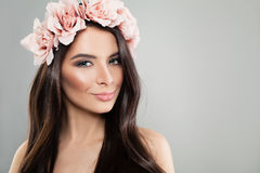 Glamorous Woman with Perfect Makeup and Summer Rose Flowers Stock Photos