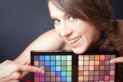 Glamorous woman pointing on colorful palette for fashion makeup Royalty Free Stock Images