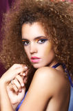 Glamorous woman portrait. Portrait of glamorous multiracial woman with long frizzy hair Royalty Free Stock Images