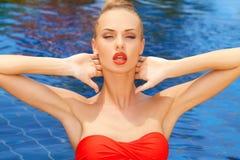Glamorous woman posing in the pool Stock Photo