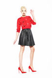 Glamorous Woman in red Blouse and Black Skirt Royalty Free Stock Photography
