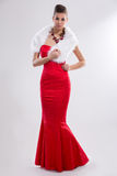 Glamorous woman in red long dress Royalty Free Stock Photography