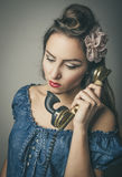 Glamorous woman using retro telephone Stock Photos