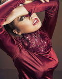 Glamorous woman wearing maroon dress Royalty Free Stock Photo