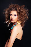 Glamorous Woman wit Curly Hair, Makeup and Accessories Stock Photo