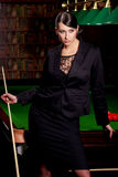 Glamorous woman witn cue Royalty Free Stock Photo