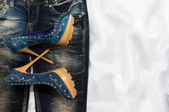 Glamorous women's fashion, jeans, shoes in rhinestones Royalty Free Stock Image