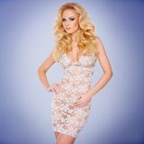 Glamorous young blond in a see-through dress Royalty Free Stock Photography