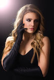 Glamorous young blonde woman in black Stock Images