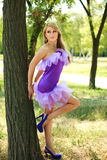 Glamorous young girl,flirting in violet Stock Images