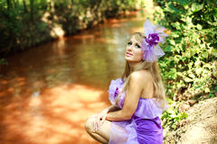 Glamorous young girl,posing in violet Stock Photo
