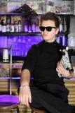 Glamorous young man sits near bar counter Stock Photos