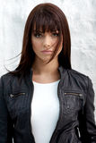 Glamorous young woman. In black leather jacket on white background Royalty Free Stock Photos