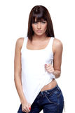 Glamorous young woman. In white shirt on white background Royalty Free Stock Photos