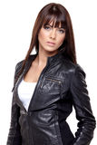 Glamorous young woman. In black leather jacket on white background Royalty Free Stock Photo