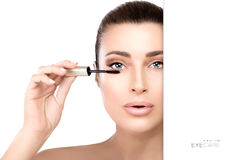 Glamorous young woman applying mascara Stock Photography
