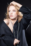 Glamorous young woman in a black jacket Stock Images