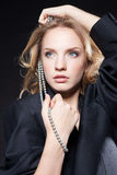 Glamorous young woman in a black jacket Royalty Free Stock Image