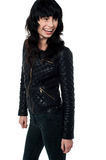 Glamorous young woman in black leather jacket Stock Photography
