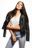 Glamorous young woman in black leather jacket on white background Royalty Free Stock Photos
