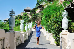 Glamorous young woman in blue dress posing outdoor.  Royalty Free Stock Photos