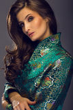 Glamorous young woman in green japanese style jacket looking at Royalty Free Stock Images