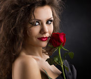 Glamorous young woman with rose Royalty Free Stock Images