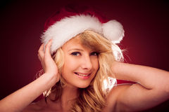 Glamorous young woman with Santa claus hat sending best  wishes Stock Images
