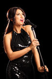 Glamorous young woman singing Stock Image