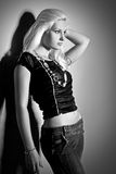 Glamorous young women in black shirt and jeans Stock Image
