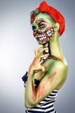 Glamorous zombie. Girl. Portrait of a pin-up zombie woman. Body-painting project. Halloween make-up Royalty Free Stock Photo