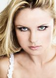 Glamour. Portrait of a blond young woman looking at the camera Stock Photo