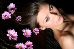 Glamour. Pink flowers in girl hair stock image