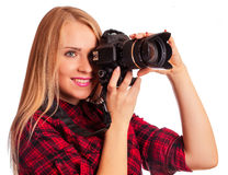 Glamour amateur photographer holding a professional camera  Royalty Free Stock Photo