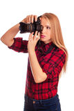 Glamour amateur photographer holding a professional camera Royalty Free Stock Images